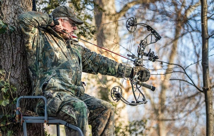 bowhunter standing on high chair