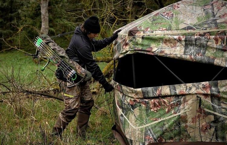 hunter prepairs his ground blind