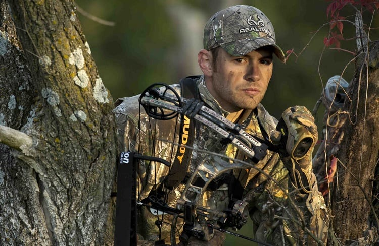 bowhunter with rangefinder