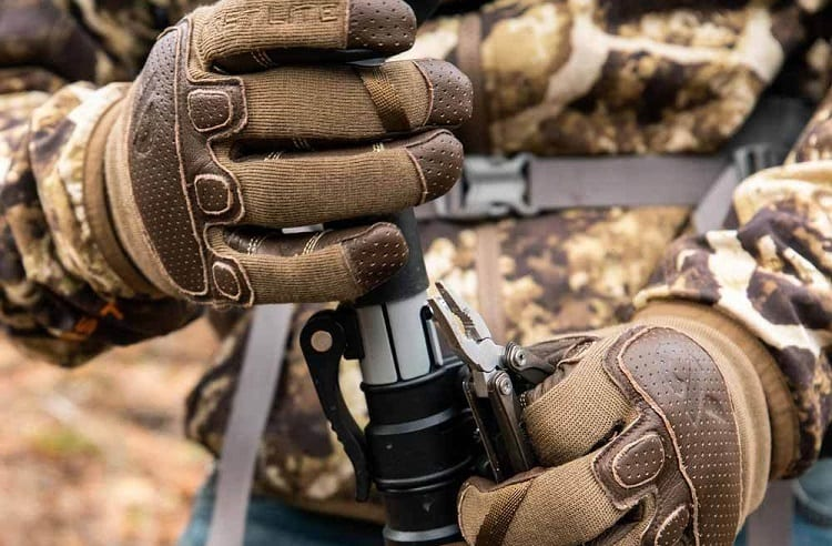 loading gun with gloves