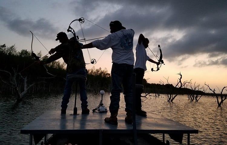 three mans bowfishing