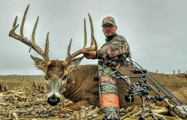 hunter with bow and killed deer